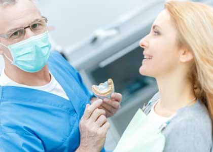 Dentist treats his patient