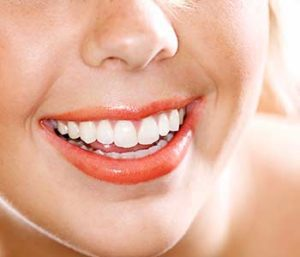 Smilling woman showing her brighter teeth